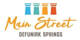 Four columns of different colors with words below saying Main Street DeFuniak Springs