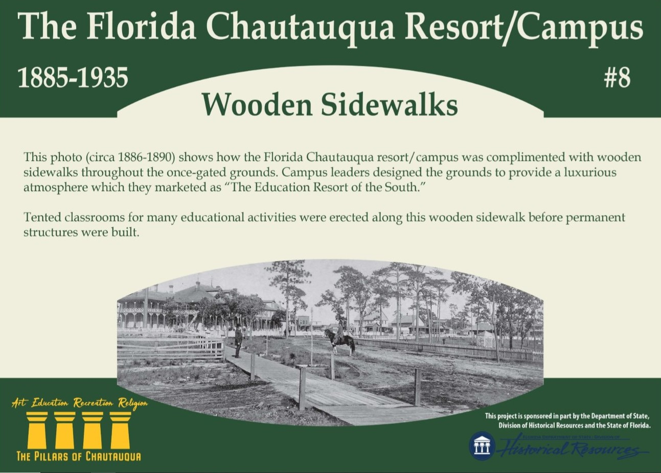 Sign about the history of wooden sidewalks in DeFuniak Springs, Florida