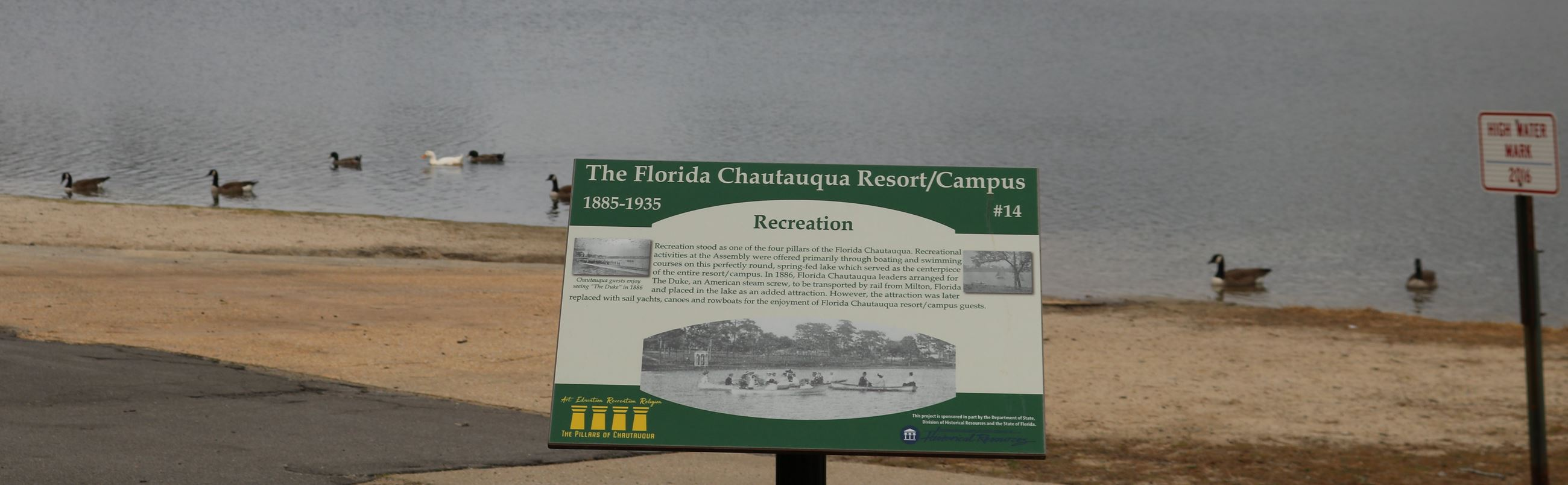 information sign next to a body of water