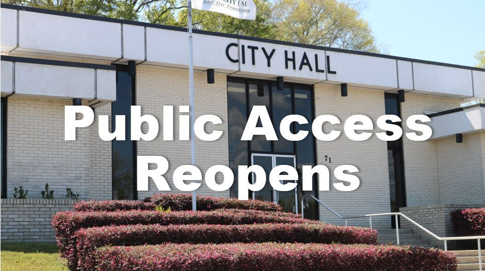 Front of City Hall with words Public Access Reopens
