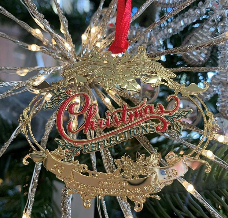 Christmas Reflections Ornament made of brass and says Christmas Reflections City of DeFuniak Springs